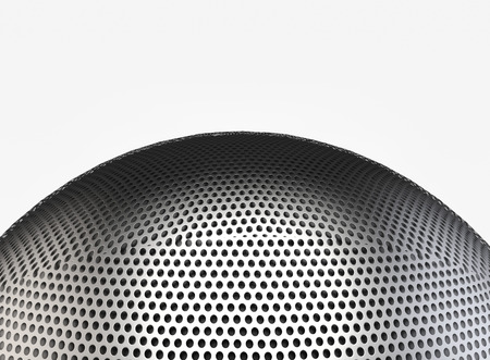 3d rendering. close up on metal Microphone head which covered by small circular holes mesh with copy space background. 写真素材