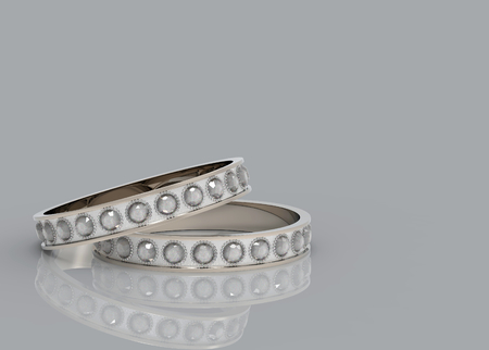 3d rendering. a couple beauty wedding diamond rings on copy space gray background. Reklamní fotografie