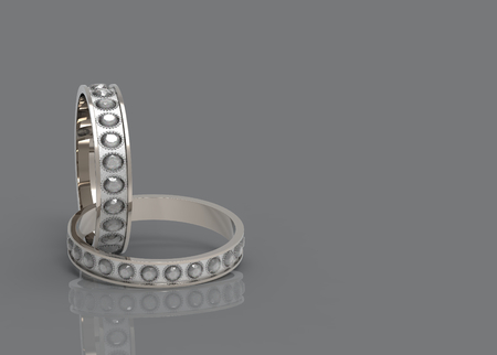 3d rendering. a couple beauty wedding diamond rings on copy space dark gray background. Reklamní fotografie