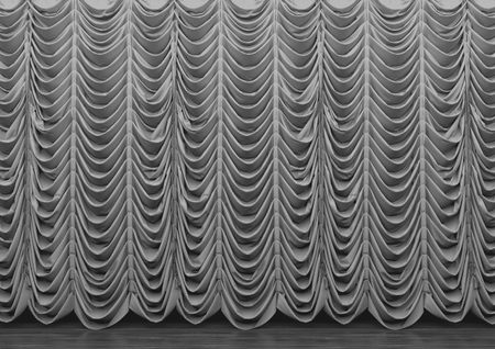 3d rendering. Long gray luxury curtains hanging on the wood stage. 写真素材