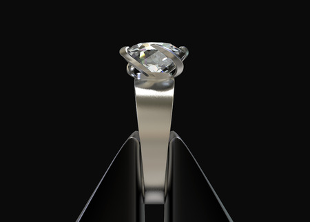 3d rendering. side view of steel stick tonging pure diamond ring   isolated on black background.