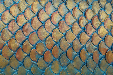 golden cement plaster in fish skin curve pattern wall background.
