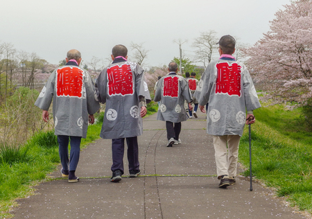 2016 April 10. Tokyo Japan. Japanese old men group wearing traditional cover and join in full blooming cherry blossom sakura festival at Hamura city. Editöryel