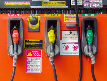 2017 April 05. Tokyo JAPAN. Japanese gasoline pipe handle hanging on dispenser at gas station.