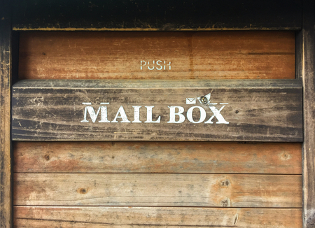 vintage old brown wood mailbox background.