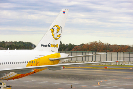 2018 December 14. Narita airport Japan. A Thai Nok scoot airline airplane parking at narita airport to prepare for next flight to Thailand.