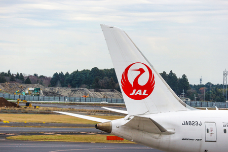 2018 December 14. Chiba Japan. A JAL airline airplane parking at Narita international airport to prepare for next flight.