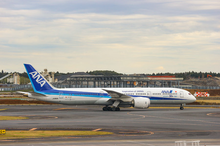 2018 December 14. Chiba Japan. An ANA airline plane running on the track after landing or prepare for take off at Narita International Airport. Editöryel