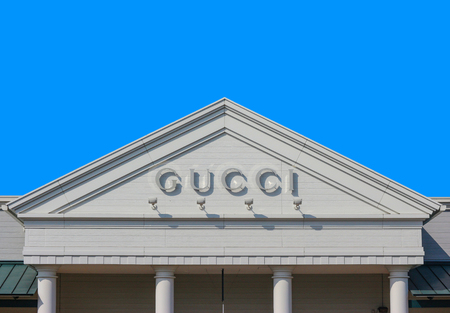 2019 March 26. Tochigi Japan. a modern design of Gucci brand name on gable roof wall with blue sky background at sano tochigi outlet mall.