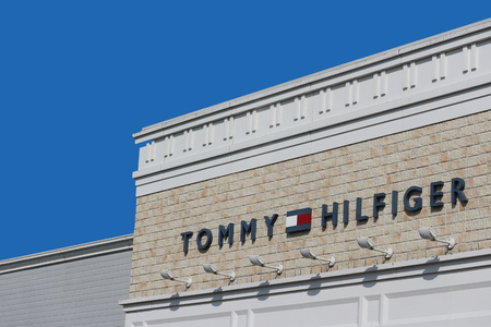 2019 March 26. Tochigi Japan. a modern design of TOMMY HILFIGER brand name logo wall with blue sky background at sano tochigi outlet mall.