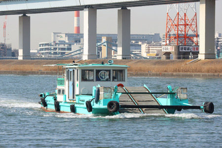 2019 March 28. Tokyo Japan. Japanese trash keeping boat flowing along river surface for cleaning every day.