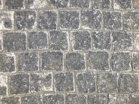 aged weathered stone paving walking way surface background. 版權商用圖片