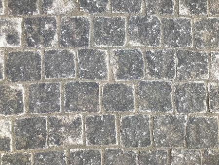 aged weathered stone paving walking way surface background. 스톡 콘텐츠