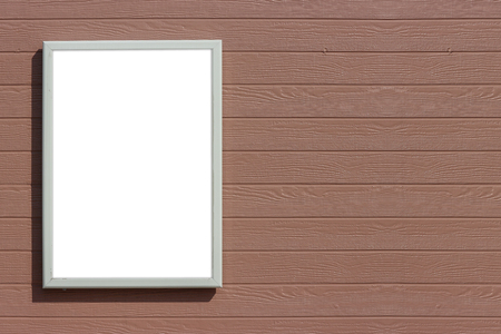empty blank white mock up board with clipping path on brown wood panels wall background. Stockfoto
