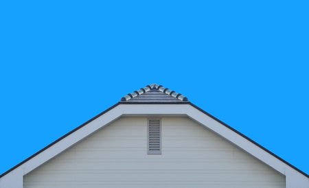modern gable roof design house wall with clear blue sky background.