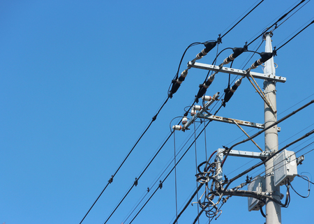 Japanese high vottage electric pole with sky background.