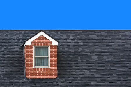 modern vintage gable roof design house wall with clear blue sky background.