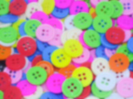 Blurred various color circle vintage buttons backgorund.