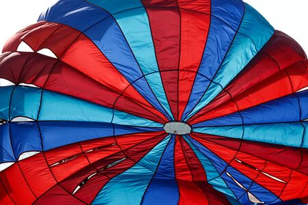 flying Water parachute umbrella on the sky background.
