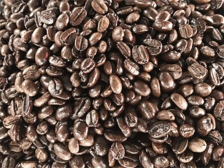 top view of fresh roasted coffee beans background.