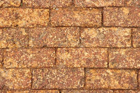 Natural laterite square brick block pavement floor ground background.