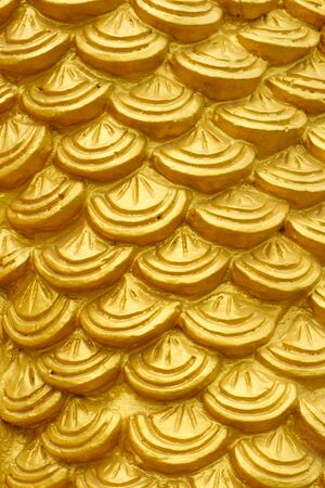 golden cement plaster in fish skin curve pattern texture wall background.