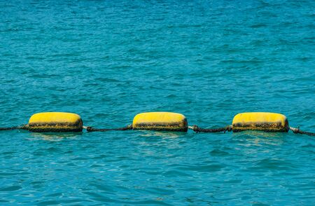yellow object floating on the sea as warning for danger area. Stockfoto