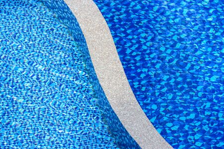 blue Child and adult swimming pool divide by paving path background.