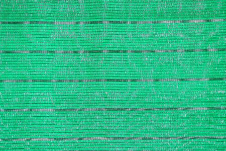 UV protection Green shading net texture surface background.