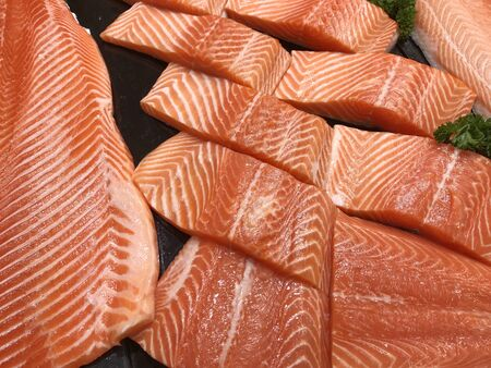 Fresh sliced salmon meat surface texture for cooking.