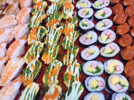 perspective view of variation sushi bar on plate background.