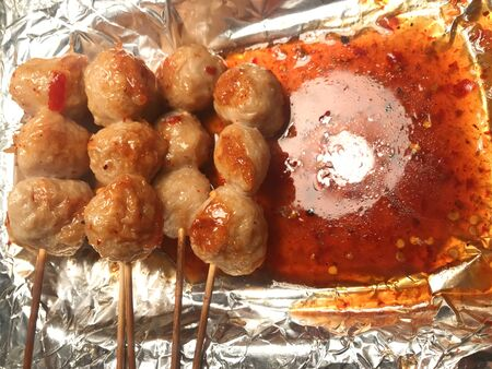 Thai pork meat balls stick with spicy sauce preparing for serving. Stockfoto