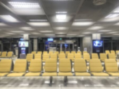 blurred yellow seat row of waiting for boarding at the airport background. 版權商用圖片