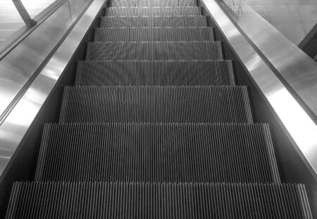 Empty escalator down stair machine indoor background.
