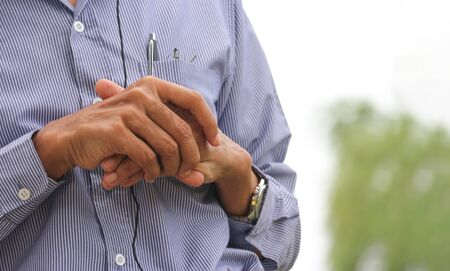 Hands of Narrative professor with blurred outdoor park as background. Standard-Bild - 133927620