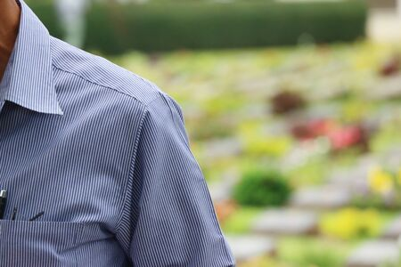 some part of long arm shirt man with blurred natural green background. Standard-Bild - 133927619