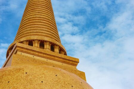 An ancient Golden Stupa, Phra Pathommachedi with blue sky background.
