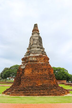 Tourist famous destination place, ruins of ancient buddha statue and Architecture at Wat Chaiwatthanaram in Ayutthaya Historical Park.