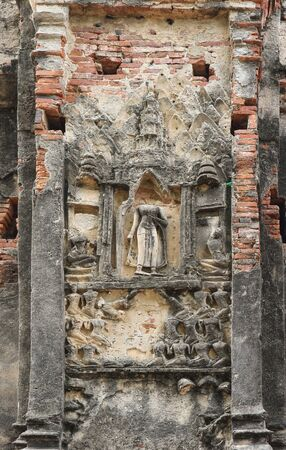 old aged ancient buddha statue, architecture wall at Ayutthaya Historical Park.