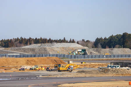 2020 March 04. Chiba JAPAN. Tractor, backhole and truck car working for developing new area of construction site work at Narita international Airport.