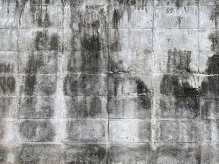 dirty weathered outdoor cement brick blocks wall background.