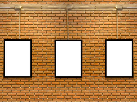 Three blank white poster mock up space frame on brick wall background.