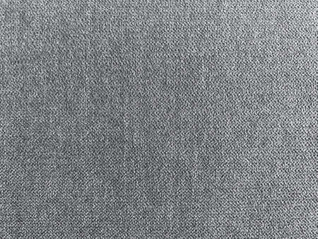 dark gray fabric cloth surface texture wall background.