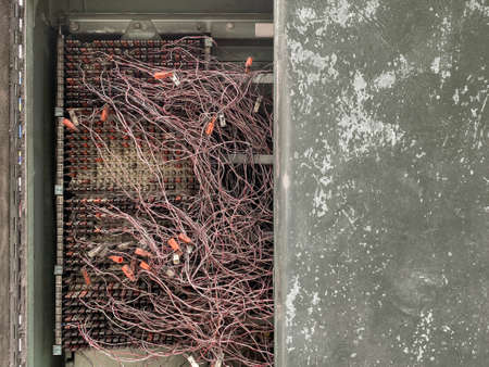 old dirty Cable connection telecommunication panel platform closet background. Stockfoto