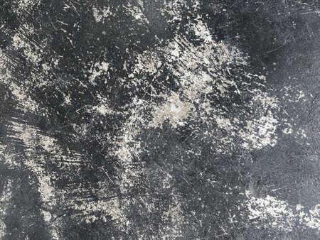 dirty crack paint on dark cement floor background. Stockfoto