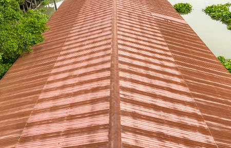 perspective view of rusty steel roof background. Stockfoto