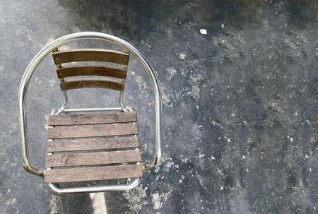 empty chair on dark cement floor background.