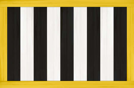 black white wood panel plate wall with yellow frame background.