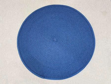 Blue Circular natural brown rattan fibers craft on white wall background Stock fotó