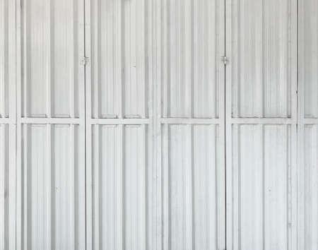 Vertical weathered steel shutter door wall background.